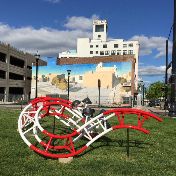 Eric Toffkin sculpture in front of David Guinn's mural